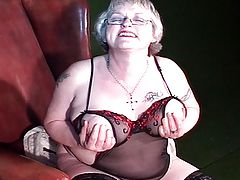 Sexy granny with big tits exposed on the chair