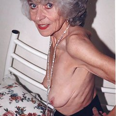 Very skinny granny shows off her bare chest