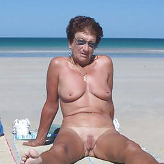 Bare grandma on the beach